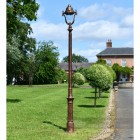 Antique Copper Finish Opulent Cast Iron Lamp Post Infront of Period Proprty