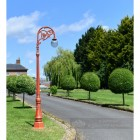 Antique Red Cast Iron Ornate Lamp Post On Driveway Setting