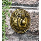 Polished Brass Lion Face bell push on brick wall