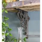 Art inspired cast shelf bracket