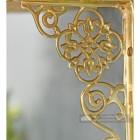 Detailed image of brass ornate shelf bracket
