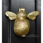 Whimsical solid brass door knocker on front door