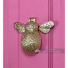 Honey bee door knocker on bright pink door