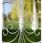Close up of wrought iron pattern on handrails