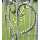 Heart shaped scroll metalwork on gazebo