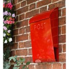 Red Letter box mounted brick on wall