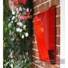 Side view of Berkley hill post box finished in red