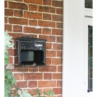 Secure post box with two keys by front door