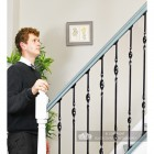 Man standing at foot of stairs