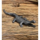 Cast iron alligator match stick holder on wood table