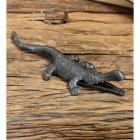 Cast iron alligator match stick holder on wood table