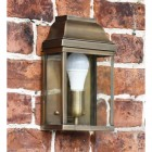 Antique Brass classic wall lantern on brick wall
