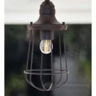 Hanging lamp finished in dark bronze
