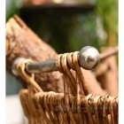 Stylish metal handles on log basket