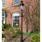 Glass and Brass Belgravia lantern and lamp post set outside town house.