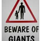 """""""Beware of Giants"""" Sign Close-up"""