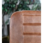 Close up of leather chair backrest