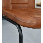 Close up of leather chair and iron frame