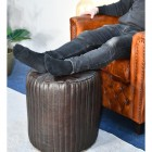 Round Goat Leather Pouffe in use
