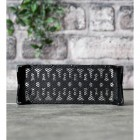 """View of the Mesh on the Back of the Black Cast Iron """"Keyhole Pattern"""" Air Brick"""