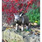 Black & Gold Piglet Garden Sculpture in the Garden
