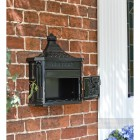 Black huntingdon post box with letter flap mounted on wall door open