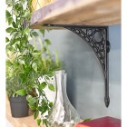 Black Iron Wall Bracket Holding Up Wooden Shelf