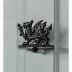 Black Iron Welsh Dragon Door Knocker On Grey Door