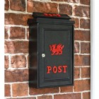 Black Post Box With Red Lettering and a Red Welsh Dragon