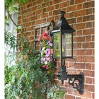 Black Victorian Wall Lantern With Brass Decoration On Wall Bracket