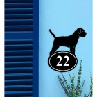 Border Terrier Iron House Number Sign on a Blue Wall