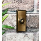 Traditional rectangle door push bell on brick wall