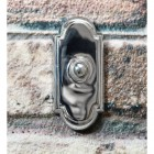 Arched Traditional Bright Chrome Door Bell on Brick Wall