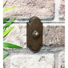 rectangle shaped burnished copper door bell push with arched top