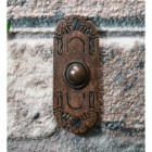 Burnished copper Bell Push on Brick wall