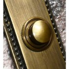 Close up of antique brass Georgian door bell button