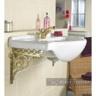 Brass Serpent Design Shelf Bracket Being Use to Hold Up a Sink