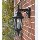 Bridlington Large Top Fix Black Wall Lantern in  Situ on a Brick Wall