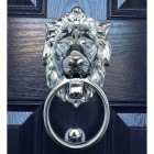 Bright Chrome Lion Door Knocker in situ on the customers door.