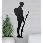 British Soldier Wall Art on the Wall Next to Plants