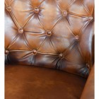 Close-up of the Brown Leather on the Arm Chair