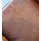View of the Brown Leather Seat of the Arm Chair