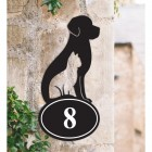 Cat & Dog Iron House Number Sign on a Garden Wall