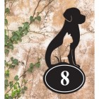 Cat & Dog Iron House Number Sign in Situ a Rustic Wall