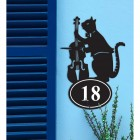 Iron Cat & Fiddle House Number Sign in Situ on a Blue Wall