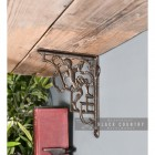 Cherub Iron Shelf Bracket Holding up a Wooden Shelf