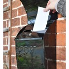 """""""Cityscape"""" Black Contemporary Post Box With Lock and Newspaper Holder in Use"""