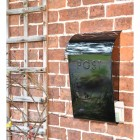 """""""Cityscape"""" Black Contemporary Post Box With Lock Holding a Newspaper"""
