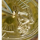 Close up of polished brass hummingbird sundail
