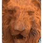 Close-up of Rustic Lion Head Garden Ornament
